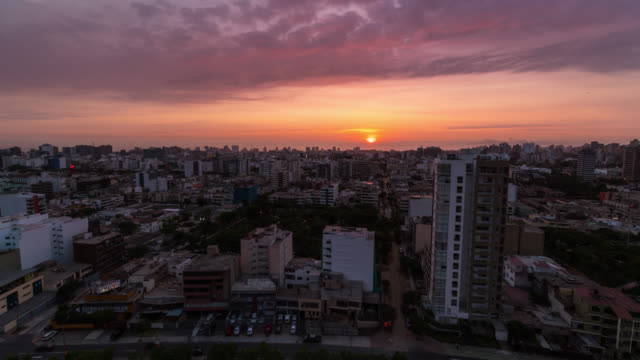 timelapse at sunset of miraflores from a roof top - lima peru stock videos and b-roll footage