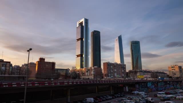 vídeos de stock e filmes b-roll de time-lapse at sunset of the cuatro torres business area in madrid - exterior de edifício