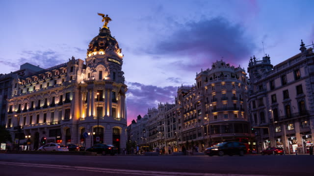 Timelapse at sunset of the Iconic Metropolis Building in Madrid