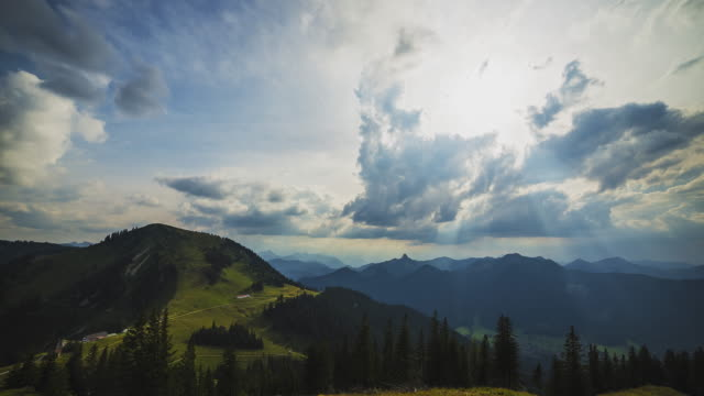T/L timelapse at the summit of mount Wallberg with view of the surrounding mountain tops and a massive storm brewing up