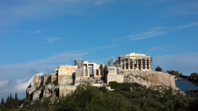 Timelapse - Athens - Greece - View of the Acropolis from the hill of Filopappou while tourists are visiting the monument