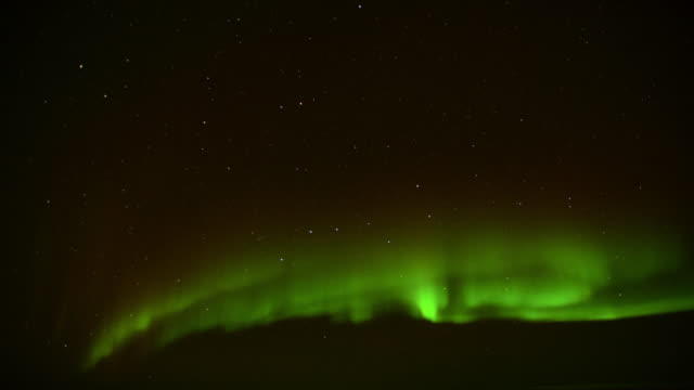 Timelapse aurora borealis lights up night sky, Canada
