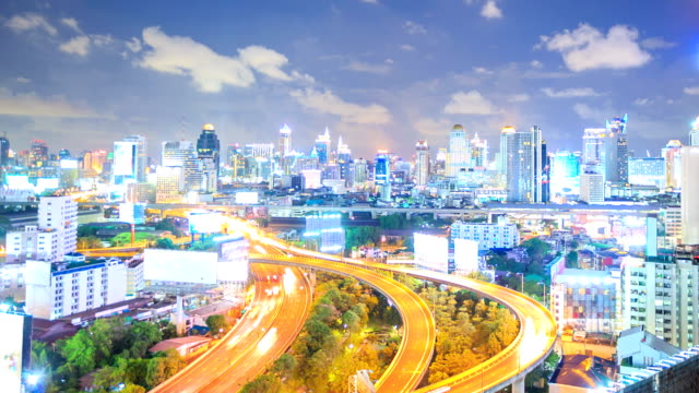HD Time-lapse: Bangkok Downtown Skyline and highway zoom out