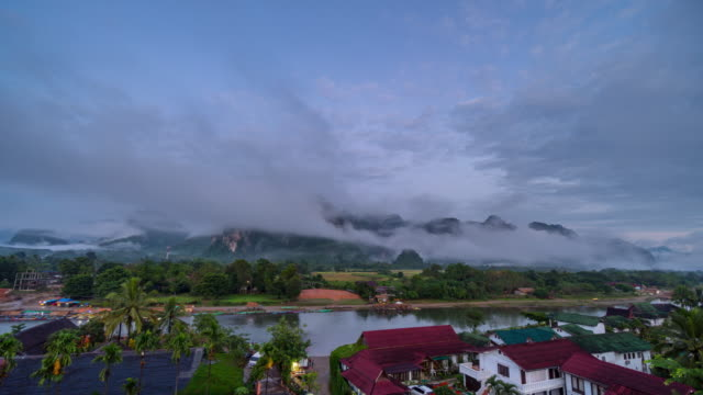 4K Time-lapse : Beautiful sunrise and fog at Viewpoint in Vang Vieng, Laos