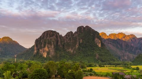 4k time-lapse : beautiful sunrise at viewpoint in vang vieng, laos - twilight stock videos & royalty-free footage