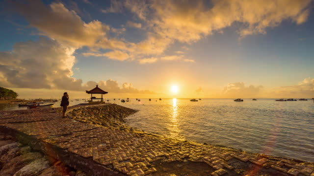 Timelapse Beautiful sunrise morning at Karang beach, Sanur in Bali, Indonesia