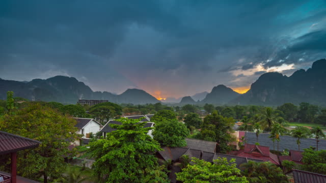 4k time-lapse : beautiful sunset at viewpoint in vang vieng, laos - village stock videos & royalty-free footage