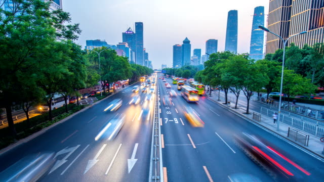 time-lapse beijing city traffic at sunset - traffic time lapse stock videos & royalty-free footage