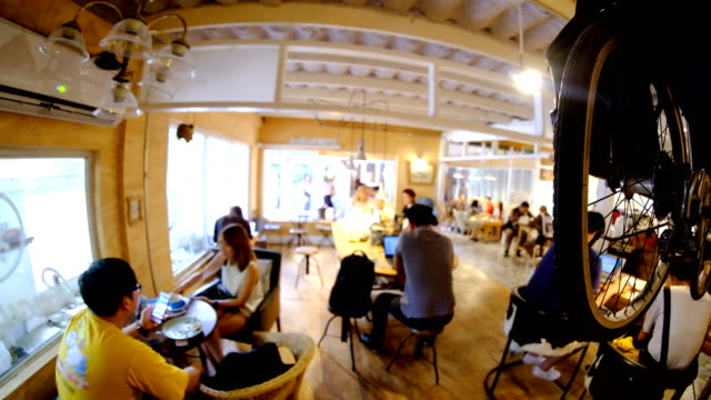 4k timelapse : blur background of cafe shop . a co-working space for student. - coworking space stock videos and b-roll footage