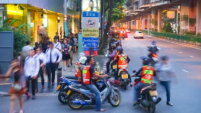 4K Time-Lapse Blurred Background Group of Thai Taxi bike in rush hour after work with crowd people and traffic on the road, evening time after work
