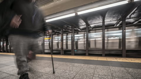 time-lapse: blurred background pedestrians crowd in new york metro subway train station - public transport stock videos & royalty-free footage