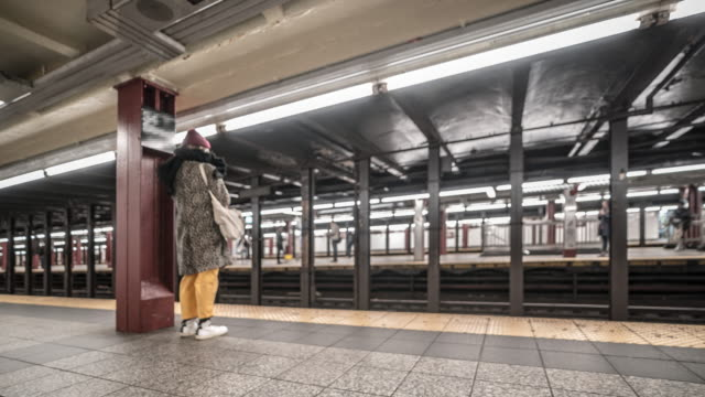 time-lapse: blurred background pedestrians crowd in new york metro subway train station - new york city penn station stock videos & royalty-free footage