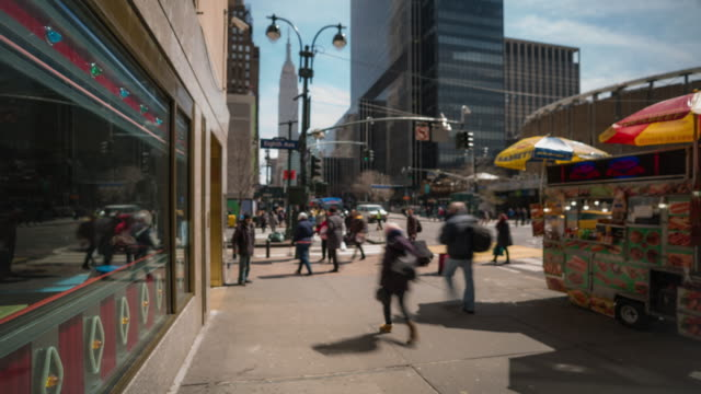 time-lapse: blurred background tourist pedestrians crowd around madison square garden pennsylvania station in new york usa - new york city penn station stock videos & royalty-free footage
