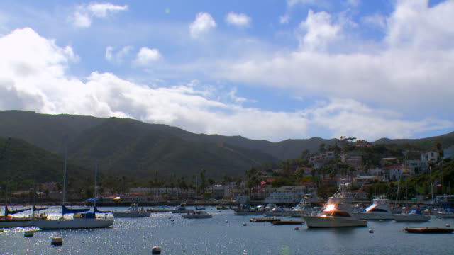 time-lapse: boats anchored in a harbor - anchored stock videos & royalty-free footage