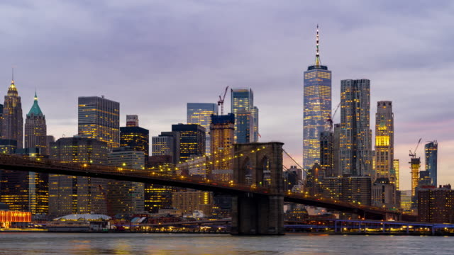 timelapse: brooklyn bridge at sunset twilight, new york city ny usa - brooklyn bridge stock videos & royalty-free footage