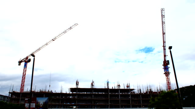 timelapse building construction site with cranes tower and sky cloudy background