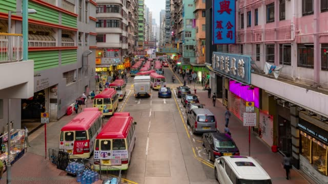 time-lapse: bus terminal at fa yuan market and lady market mongkok, nathan road in kowloon hong kong - ward stock videos & royalty-free footage