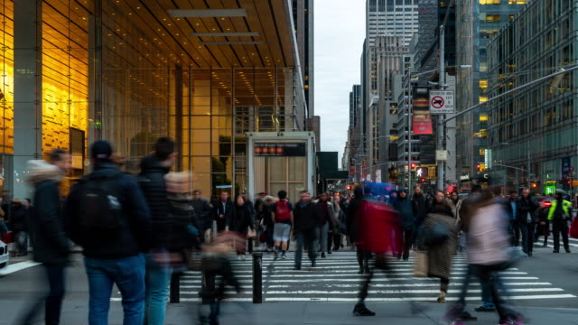 time-lapse: businessman and worker pedestrian crowded at bryant park times square new york city usa sunset - fifth avenue stock videos & royalty-free footage
