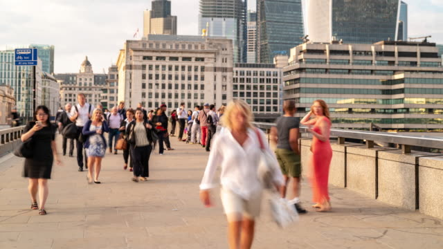 time-lapse: businessman crowd at london bridge and downtown skylines building in london england uk - organisation stock videos & royalty-free footage