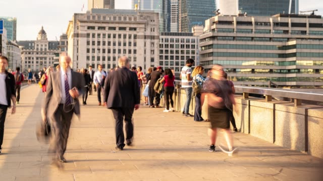 time-lapse: businessman crowd at london bridge and downtown skylines building in london england uk - double decker bus stock videos & royalty-free footage