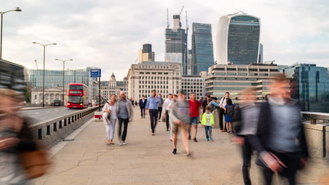 time-lapse: businessman crowd at london bridge and downtown skylines building in london england uk - organised group stock videos & royalty-free footage