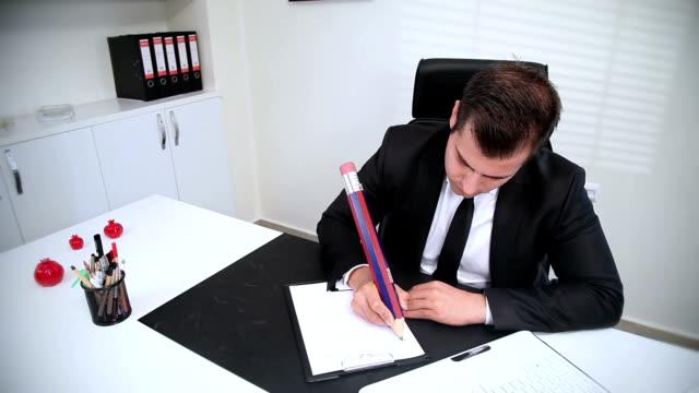 vidéos et rushes de timelapse: homme d'affaires prenant des notes - culture d'entreprise