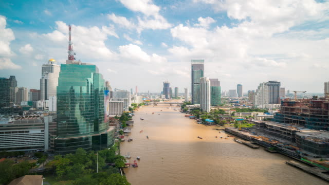 time-lapse busy transportation in chaophraya river with bangkok skyline - king of thailand stock videos and b-roll footage