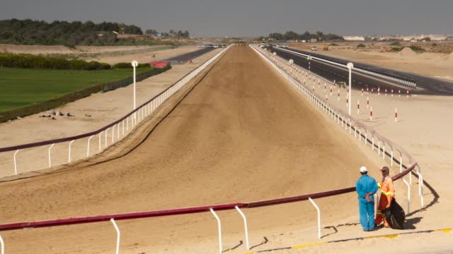Timelapse camels run around racing track, Abu Dhabi, UAE
