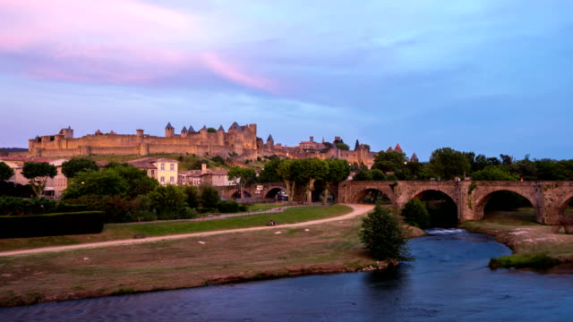 hd timelapse: carcassonne cityscape france at dusk - carcassonne stock videos & royalty-free footage