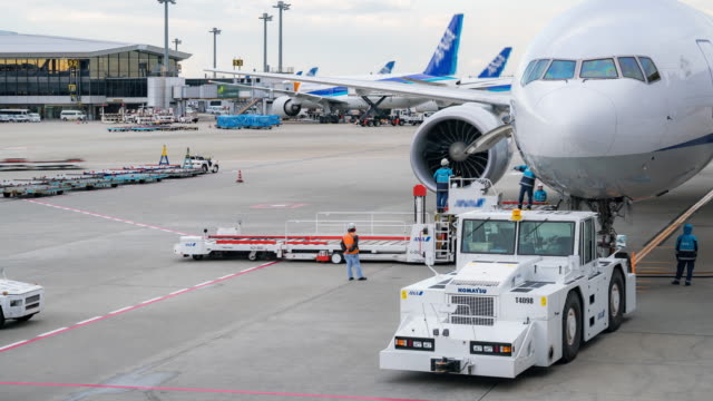 time-lapse: cargo loading to airplane for air freight logistic background - aerospace stock videos & royalty-free footage