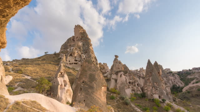 timelapse : cave houses  cappadocia region valley, canyon, hills located between the volcanic mountains - cliff dwelling stock videos & royalty-free footage