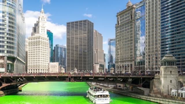 time-lapse: chicago river dyeing river green with skyline cityscape on st patrick's day in chicago il usa - st patrick's day stock videos & royalty-free footage