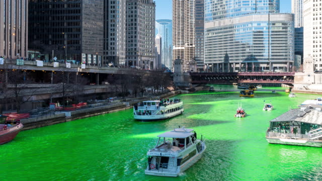 time-lapse: chicago river dyeing river green with skyline cityscape on st patrick's day in chicago il usa - north america stock videos & royalty-free footage
