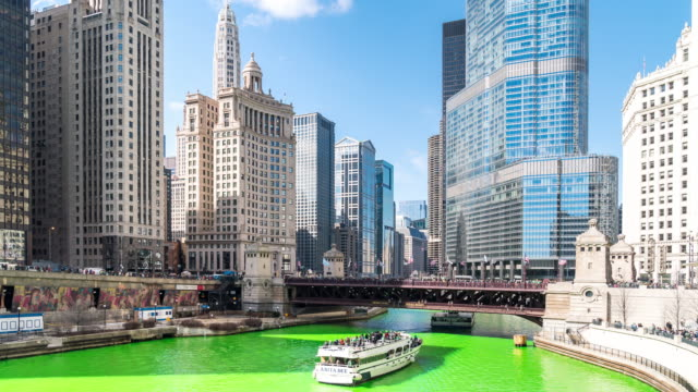 time-lapse: chicago river dyeing river green with skyline cityscape on st patrick's day in chicago il usa - st. patrick's day stock videos & royalty-free footage
