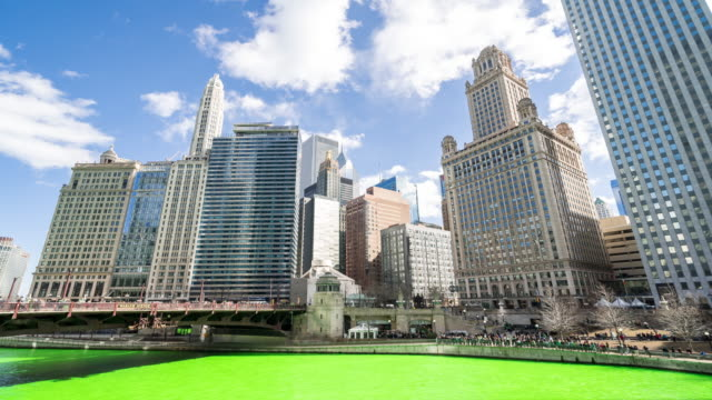 time-lapse: chicago river dyeing river green with skyline cityscape on st patrick's day in chicago il usa - chicago river stock videos & royalty-free footage