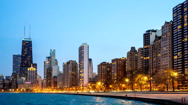HD Time-lapse: Chicago Skyline along Michigan Lake at dusk USA