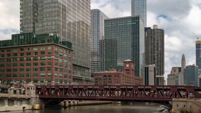 time-lapse: chicago skyline buildings at downtown with chicago river near wolf point, il usa - chicago loop stock videos and b-roll footage