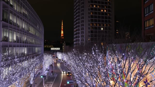 time-lapse: christmas illuminations at roppongi hills with tokyo tower - roppongi stock videos and b-roll footage