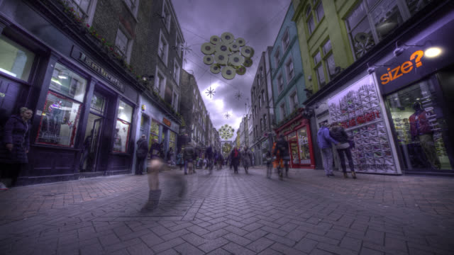 Timelapse Christmas shoppers on Carnaby Street, London, UK