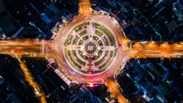 timelapse circle traffic in the city at night - aerial view stock videos & royalty-free footage
