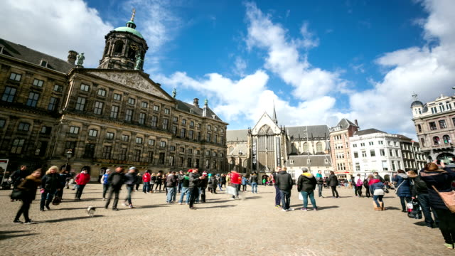 hd time-lapse: city pedestrian at dam square amsterdam and palace - square composition stock videos & royalty-free footage