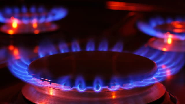timelapse close up zoom in to burning gas rings on a natural gas cooker - hob stock videos & royalty-free footage