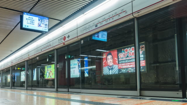 4k timelapse: cloud of peoples waiting for metro subway, hong kong - getting on stock videos & royalty-free footage