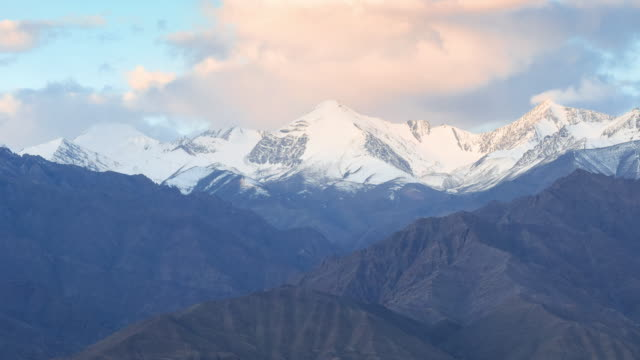 4K Time-lapse: clouds and shadow over himalayan mountain range at sunrise, Ladakh province, India