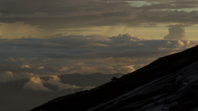 timelapse clouds billow as sun sets, mount kinabalu, borneo - mt kinabalu national park stock videos and b-roll footage