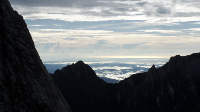 timelapse clouds billow over rocky peak, mount kinabalu, borneo - mt kinabalu national park stock videos and b-roll footage
