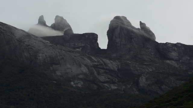 timelapse clouds billow over rocky peaks, mount kinabalu, borneo - mt kinabalu national park stock videos and b-roll footage
