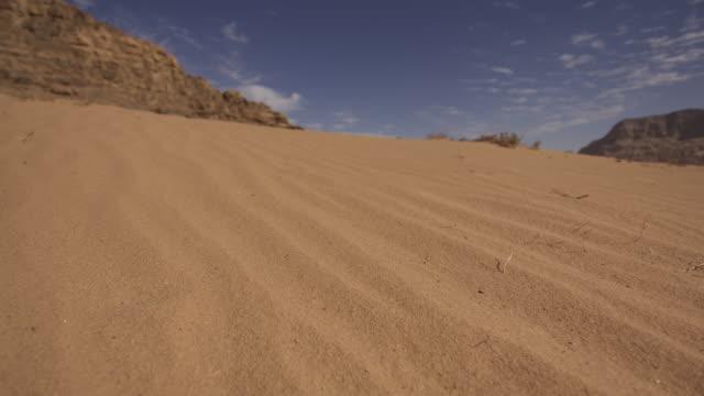 timelapse clouds drift over sand dune in desert valley, wadi rum, jordan - sand dune stock videos and b-roll footage