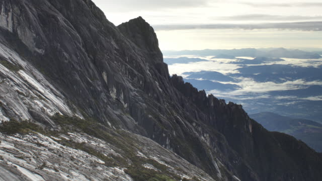 timelapse clouds enshroud rocky ridge, mount kinabalu, borneo - mt kinabalu national park stock videos and b-roll footage