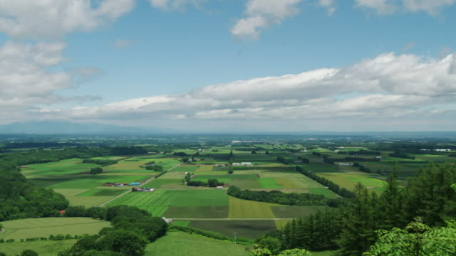 time-lapse, clouds flowing above tokachi plain, hokkaido, japan - satoyama scenery stock videos & royalty-free footage